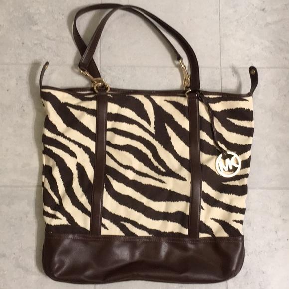 00eafe5a543a Brown Animal print Michael Kors Tote Bag. M_5a5d57b072ea8801b700febc